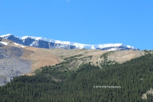 Look at how thick the snow is on top of the mountain!