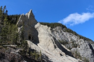 In this picture you can see the cave opening and the hoodoos